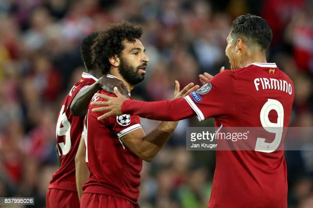 Mohamed Salah of Liverpool celebrates scoring his sides third goal with Roberto Firmino of Liverpool during the UEFA Champions League Qualifying...