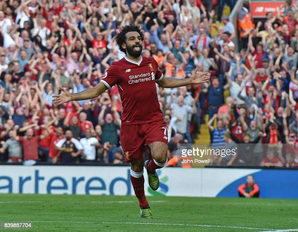 Mohamed Salah of Liverpool celebrates scoring his team's third goal during the Premier League match between Liverpool and Arsenal at Anfield on...