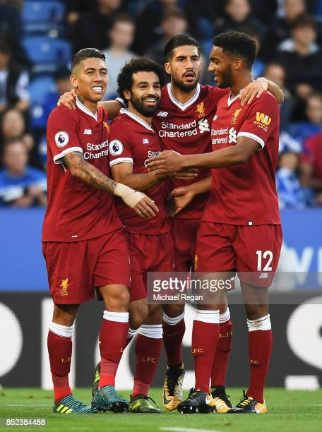Mohamed Salah of Liverpool celebrates with team mates after scoring his sides first goal during the Premier League match between Leicester City and...