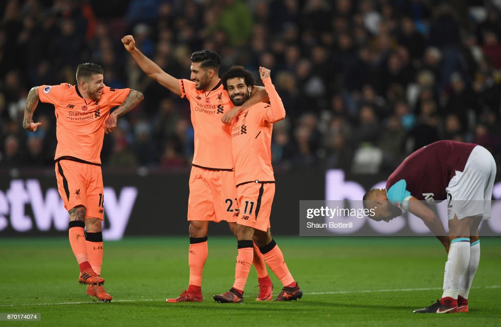 Mohamed Salah of Liverpool celebrates with team mates after scoring his sides fourth goal during the Premier League match between West Ham United and Liverpool at London Stadium on November 4, 2017 in London, England.