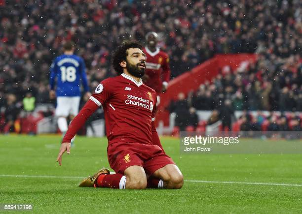 Mohamed Salah of Liverpool Celebratres his opener during the Premier League match between Liverpool and Everton at Anfield on December 10 2017 in...