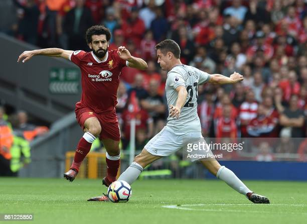 Mohamed Salah of Liverpool competes with Ander Herrera of Manchester United during the Premier League match between Liverpool and Manchester United...