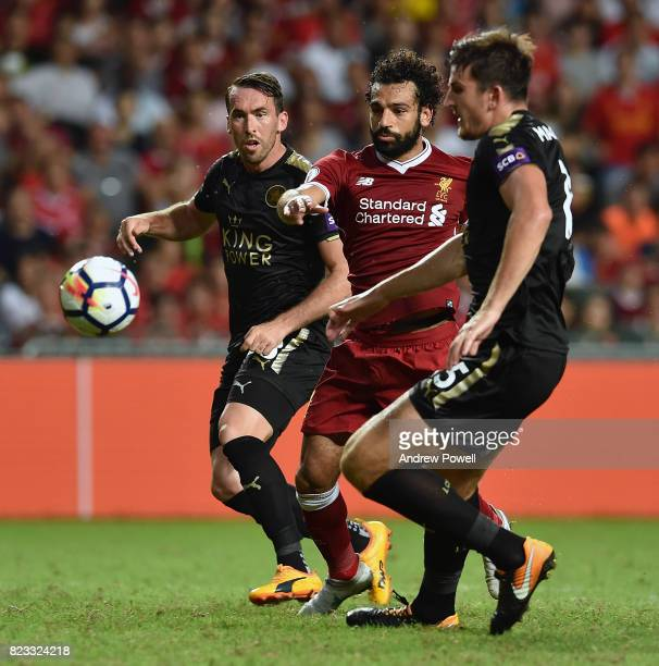Mohamed Salah of Liverpool competes with Christian Fuchs and Harry Maguire of Leicester City during the Premier League Asia Trophy match between...