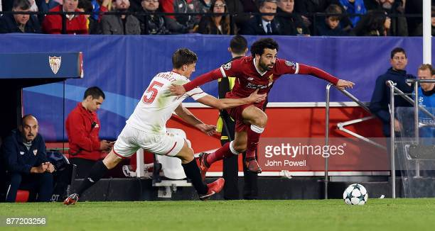 Mohamed Salah of Liverpool competes with Clement Lenglet of Sevilla FC during the UEFA Champions League group E match between Sevilla FC and...