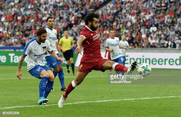 Mohamed Salah of Liverpool competes with Karim Rekik of Hertha BSC during the preseason friendly match between Hertha BSC and FC Liverpool at...