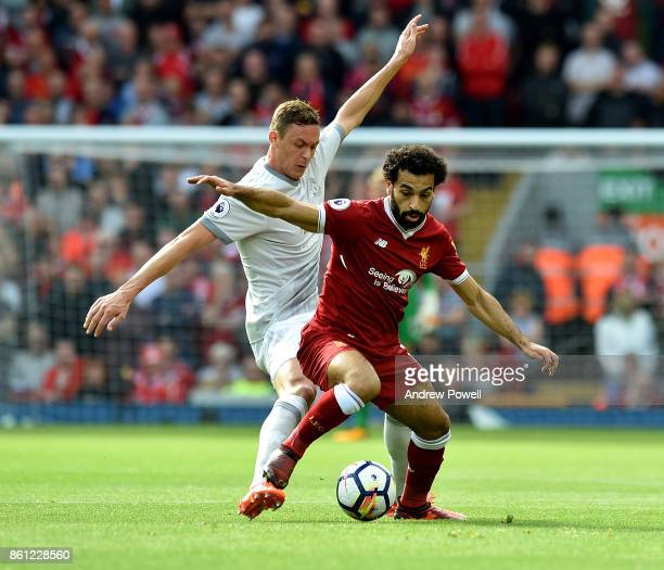 Mohamed Salah of Liverpool competes with Memanja Matic of Manchester United during the Premier League match between Liverpool and Manchester United...
