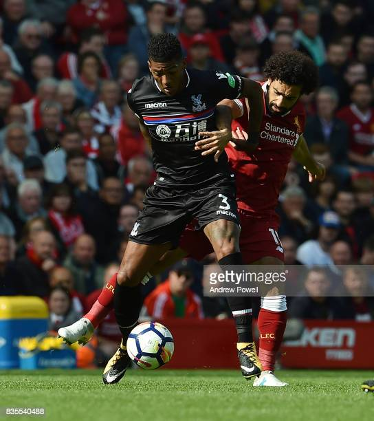 Mohamed Salah of Liverpool competes with Patrick Van Aanholt of Crystal Palace during the Premier League match between Liverpool and Crystal Palace...