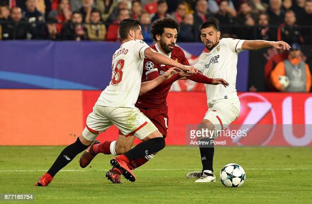 Mohamed Salah of Liverpool competes with Sergio Escudero of Sevilla FC during the UEFA Champions League group E match between Sevilla FC and...