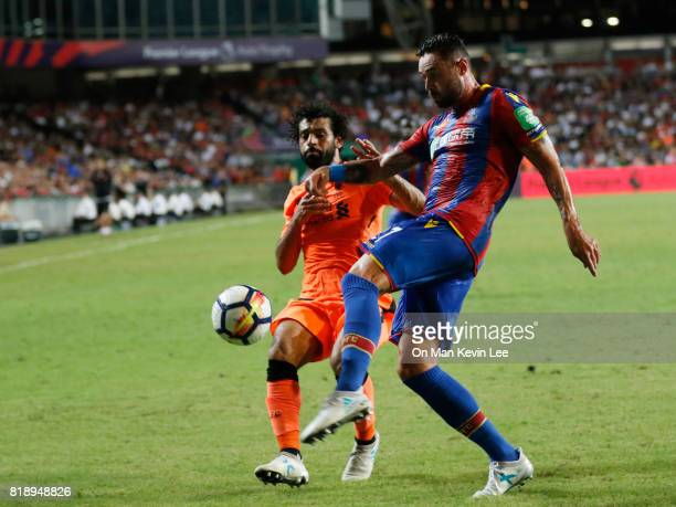 Mohamed Salah of Liverpool FC competes for the ball with Damien Delaney of Crystal Palace FC during the Premier League Asia Trophy match between...