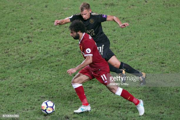 Mohamed Salah of Liverpool holds off Marc Albrighton of Leicester City during the Premier League Asia Trophy match between Liverpool FC and Leicester...