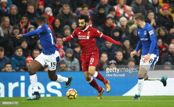 Mohamed Salah of Liverpool is chased by Gylfi Sigurdsson and Cuco Martina of Everton during the Premier League match between Liverpool and Everton at...