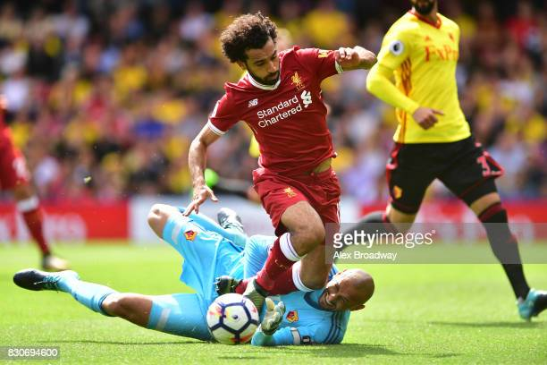 Mohamed Salah of Liverpool is fouled by Heurelho Gomes of Watford and a penalty is awarded to Liverpool during the Premier League match between...