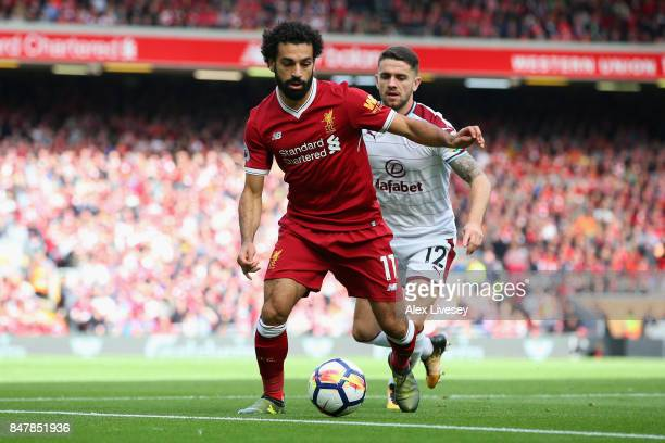 Mohamed Salah of Liverpool is put under pressure from Robbie Brady of Burnley during the Premier League match between Liverpool and Burnley at...