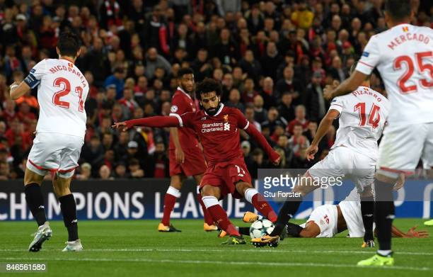 Mohamed Salah of Liverpool scores his sides second goal during the UEFA Champions League group E match between Liverpool FC and Sevilla FC at Anfield...