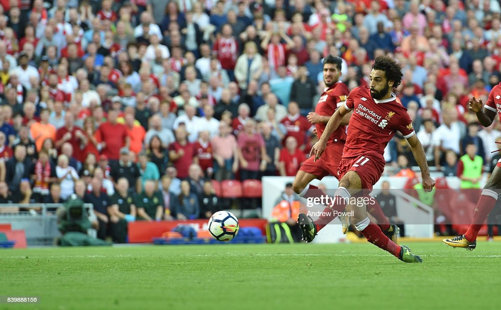 Mohamed Salah of Liverpool scores his team's third goal during the Premier League match between Liverpool and Arsenal at Anfield on August 27, 2017 in Liverpool, England.