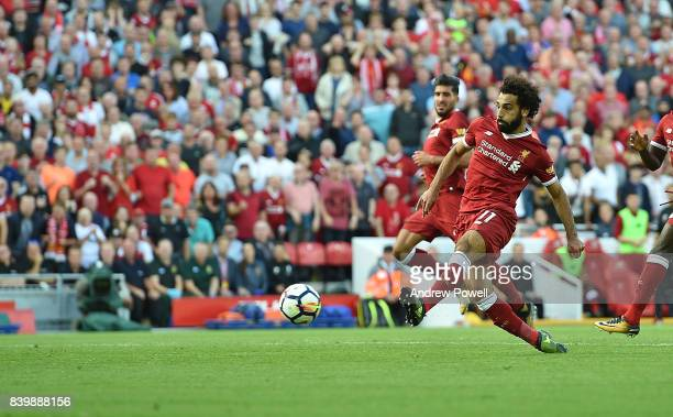 Mohamed Salah of Liverpool scores his team's third goal during the Premier League match between Liverpool and Arsenal at Anfield on August 27 2017 in...