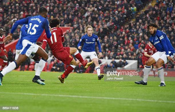 Mohamed Salah of Liverpool Scores tghe opener during the Premier League match between Liverpool and Everton at Anfield on December 10 2017 in...