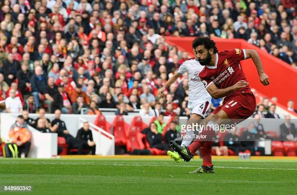 Mohamed Salah of Liverpool scores the equalizer during the Premier League match between Liverpool and Burnley at Anfield on September 16 2017 in...