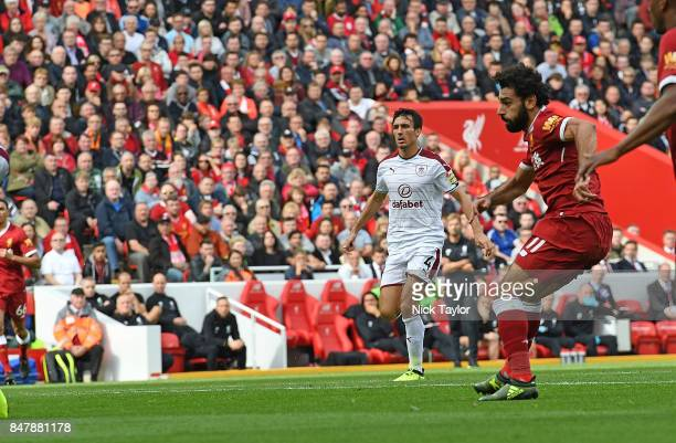 Mohamed Salah of Liverpool Scores the Equiliser during the Premier League match between Liverpool and Burnley at Anfield on September 16 2017 in...