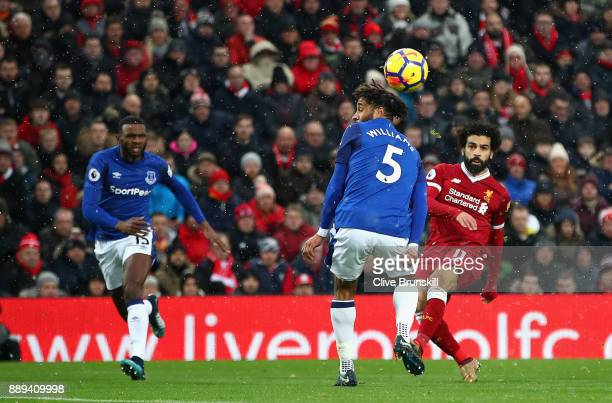 Mohamed Salah of Liverpool scores the first Liverpool goal during the Premier League match between Liverpool and Everton at Anfield on December 10...