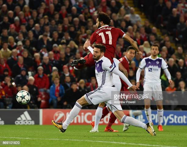 Mohamed Salah of Liverpool scores the opening goal during the UEFA Champions League group E match between Liverpool FC and NK Maribor at Anfield on...