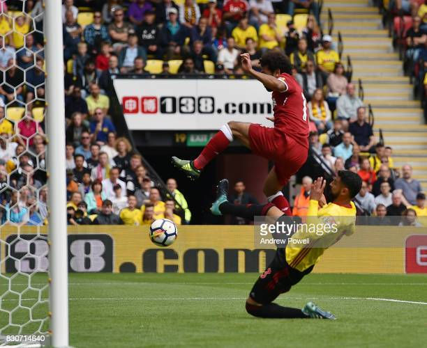 Mohamed Salah of Liverpool scores the third during the Premier League match between Watford and Liverpool at Vicarage Road on August 12 2017 in...