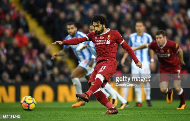 Mohamed Salah of Liverpool takes a penalty during the Premier League match between Liverpool and Huddersfield Town at Anfield on October 28 2017 in...