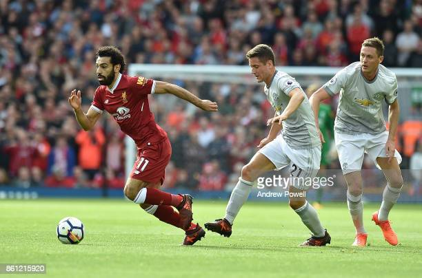 Mohamed Salah of Liverpool with Ander Herrera of Manchester Utd during the Premier League match between Liverpool and Manchester United at Anfield on...