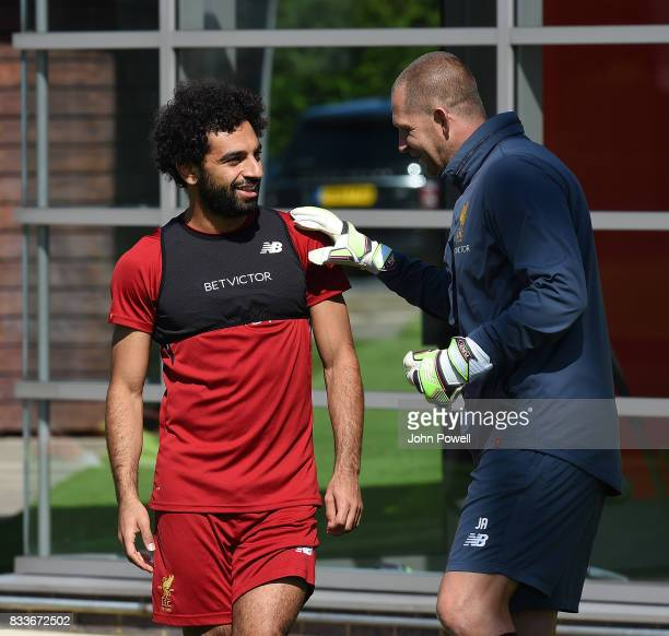 Mohamed Salah of Liverpool with goal keeper coach John Achterberg during a training session at Melwood Training Ground on August 17 2017 in Liverpool...