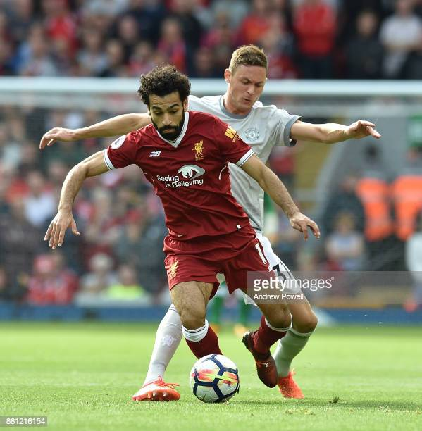 Mohamed Salah of Liverpool with Nemanja matic of Manchester Utd during the Premier League match between Liverpool and Manchester United at Anfield on...