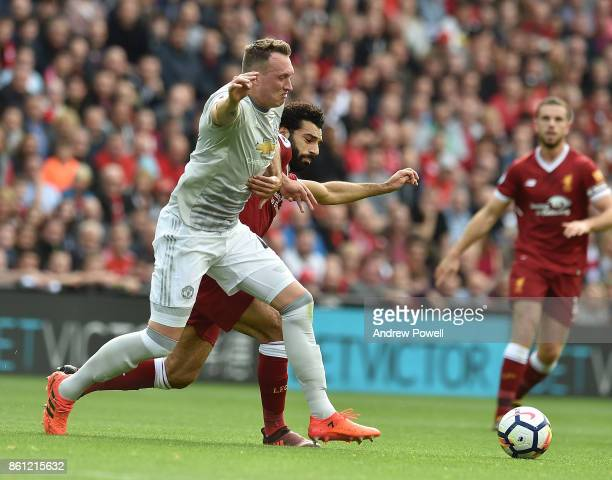 Mohamed Salah of Liverpool with Phil Jones of Manchester Utd during the Premier League match between Liverpool and Manchester United at Anfield on...