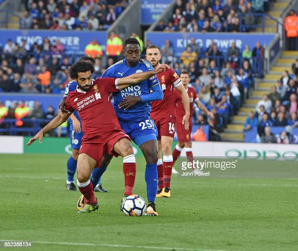 Mohamed Salah of Liverpool with Wilfred Ndidi of Leicester during the Premier League match between Leicester City and Liverpool at The King Power...