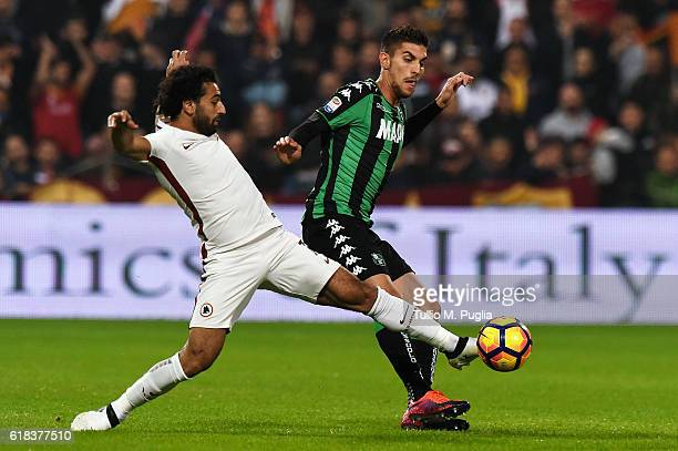 Mohamed Salah of Roma and Lorenzo Pellegrini of Sassuolo compete for the ball during the Serie A match between US Sassuolo and AS Roma at Mapei...