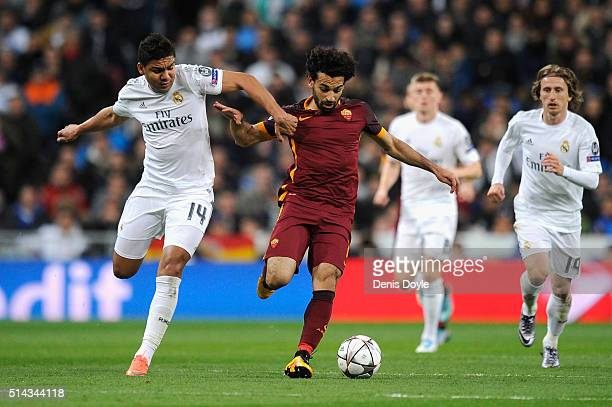 Mohamed Salah of Roma is challenged by Casemiro of Real Madrid during the UEFA Champions League Round of 16 Second Leg match between Real Madrid and...