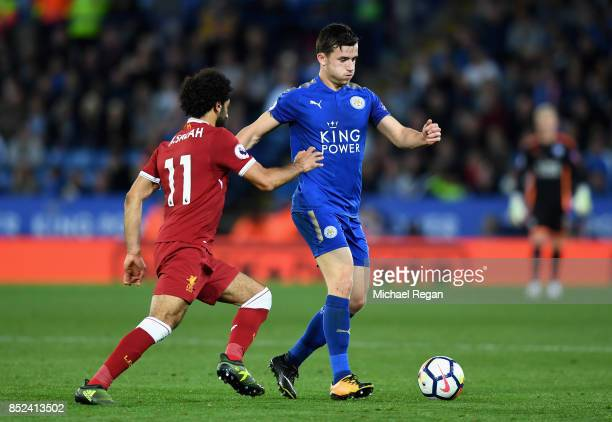 Mohamed Salah ofLiverpool puts pressure on Ben Chilwell of Leicester City during the Premier League match between Leicester City and Liverpool at The...