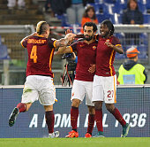 Mohamed Salah with his teammates Radja Nainggolan and Gervinho of AS Roma celebrates after scoring the team's third goal during the Serie A match...