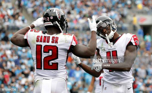 Mohamed Sanu celebrates with teammate Julio Jones of the Atlanta Falcons after a touchdown against the Carolina Panthers in the first quarter during...