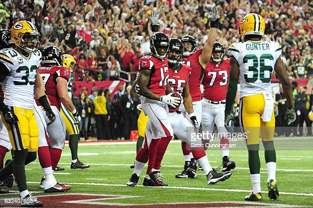 Mohamed Sanu of the Atlanta Falcons celebrates scoring a first quarter 2yard touchdown with Chris Chester against the Green Bay Packers in the NFC...