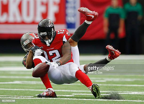 Mohamed Sanu of the Atlanta Falcons fails to pull in this reception against Brent Grimes of the Tampa Bay Buccaneers at Georgia Dome on September 11...