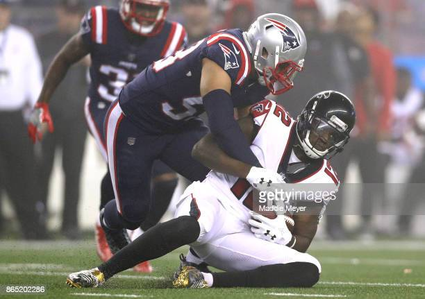 Mohamed Sanu of the Atlanta Falcons is tackled by Kyle Van Noy of the New England Patriots during the second quarter of a game at Gillette Stadium on...