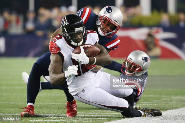 Mohamed Sanu of the Atlanta Falcons is tackled during a game against the New England Patriots at Gillette Stadium on October 22 2017 in Foxboro...