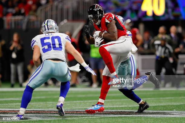 Mohamed Sanu of the Atlanta Falcons makes a catch during the first half against the Dallas Cowboys at MercedesBenz Stadium on November 12 2017 in...