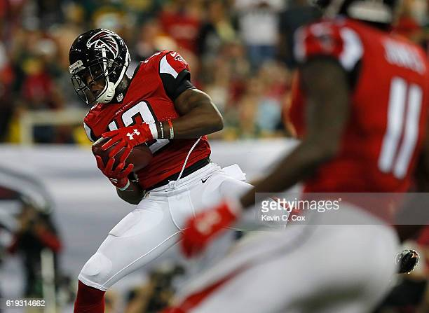 Mohamed Sanu of the Atlanta Falcons pulls in the gametying touchdown against the Green Bay Packers at Georgia Dome on October 30 2016 in Atlanta...
