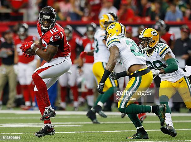Mohamed Sanu of the Atlanta Falcons pulls in this reception against Ha Ha ClintonDix and Demetri Goodson of the Green Bay Packers at Georgia Dome on...