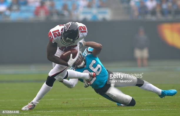 Mohamed Sanu of the Atlanta Falcons runs the ball against Daryl Worley of the Carolina Panthers in the first quarter during their game at Bank of...