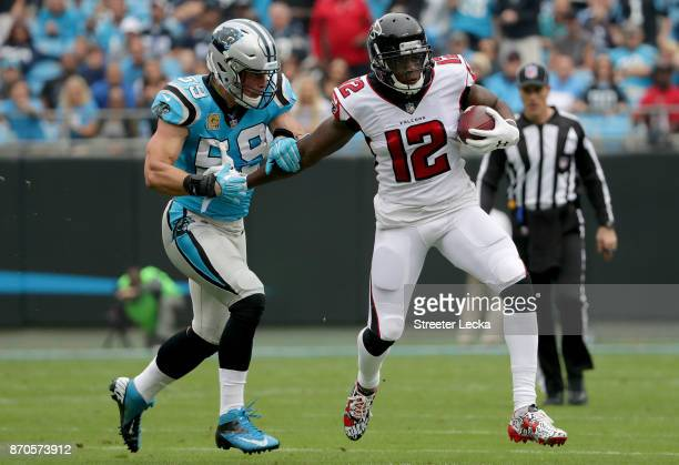 Mohamed Sanu of the Atlanta Falcons runs the ball against Luke Kuechly of the Carolina Panthers in the first quarter during their game at Bank of...