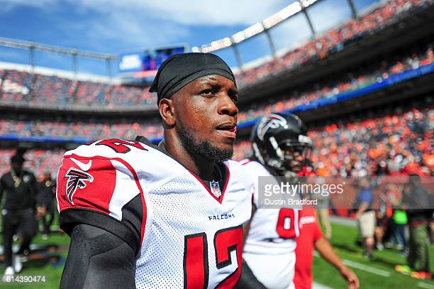 Mohamed Sanu of the Atlanta Falcons walks off the field after player warm ups before a game against the Denver Broncos at Sports Authority Field at...
