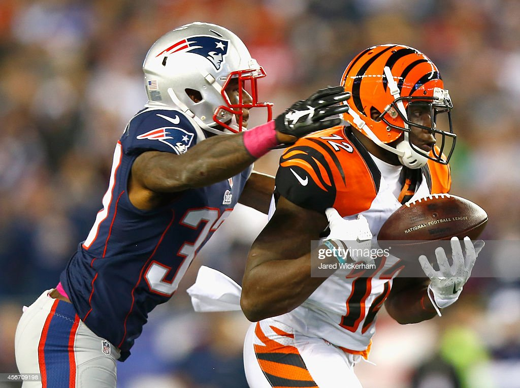 <a gi-track='captionPersonalityLinkClicked' href=/galleries/search?phrase=Mohamed+Sanu&family=editorial&specificpeople=6379095 ng-click='$event.stopPropagation()'>Mohamed Sanu</a> #12 of the Cincinnati Bengals attempts to catch a pass as <a gi-track='captionPersonalityLinkClicked' href=/galleries/search?phrase=Alfonzo+Dennard&family=editorial&specificpeople=5651216 ng-click='$event.stopPropagation()'>Alfonzo Dennard</a> #37 of the New England Patriots defends during the second quarter at Gillette Stadium on October 5, 2014 in Foxboro, Massachusetts.