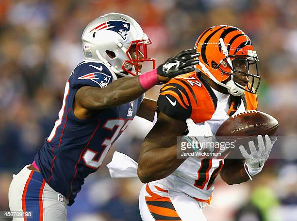 Mohamed Sanu of the Cincinnati Bengals attempts to catch a pass as Alfonzo Dennard of the New England Patriots defends during the second quarter at...
