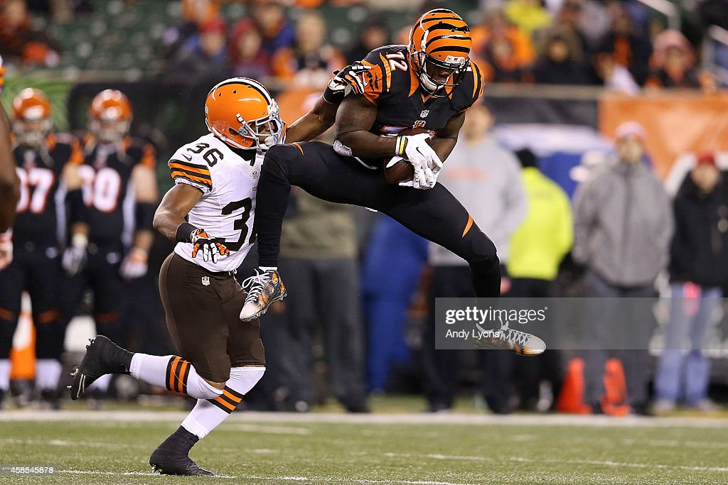 Mohamed Sanu #12 of the Cincinnati Bengals catches a pass in front of K'Waun Williams #36 of the Cleveland Browns during the fourth quarter at Paul Brown Stadium on November 6, 2014 in Cincinnati, Ohio.